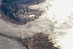 Aerial of the glaciers and mountains of the arctic area around Greenland Stock Photo