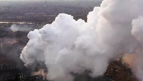 Aerial. GLOBAL WARMING. View of high chimney pipes with grey smoke. stock footage