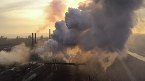Aerial. GLOBAL WARMING. View of high chimney pipes with grey smoke. stock video