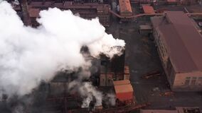 Aerial. GLOBAL WARMING. View of high chimney pipes with grey smoke. stock video footage
