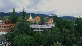 Aerial of Golden Buddhist Temple on Top of Mountain in Chiang Mai, Doi Suthep, Northern Thailand 04