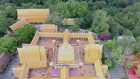 Aerial of golden buddhist temple on top of mountain in Chiang Mai, Doi Suthep, Northern Thailand 03