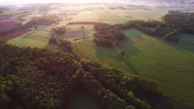 Aerial golden sunrise over the village stock video footage
