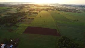 Aerial golden sunrise over the village stock video