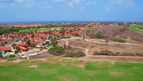 Aerial from a golf course on Aruba island in the Caribbean stock video footage