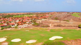 Aerial from a golf course on Aruba island in the Caribbean stock video
