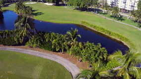 Aerial golf course flyover stock video footage