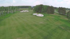 Aerial Golf course with gorgeous green and sand bunker. Aerial view on Golf course with gorgeous green and pond. Golf stock video