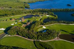Aerial golf course landscape shot with a drone. Aerial golf course landscape image shot with a drone green by the water Royalty Free Stock Image