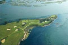 Aerial golf on ocean Stock Photo