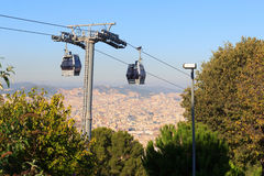 Aerial gondola lift with cable car and Barcelona cityscape panorama seen from Montjuic Royalty Free Stock Photo