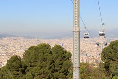 Aerial gondola lift with cable car and Barcelona cityscape panorama seen from Montjuic, Spain Stock Photos