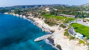Aerial governor`s beach, Limassol. Aerial view of coastline and landmark big white chalk rock at Governor`s beach, Limassol, Cyprus. The steep stone cliffs and Royalty Free Stock Photo