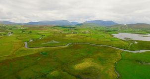 Aerial of green farmland 4k. Aerial of green farmland on a sunny day 4k stock video footage