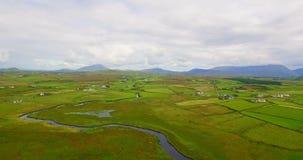 Aerial of green farmland 4k. Aerial of green farmland on a sunny day 4k stock video