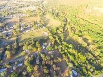 Scenic aerial view of green suburban area of Ozark, Arkansas, US. Aerial green suburban area near forest of Ozark, Arkansas, USA in autumn. Top overhead Royalty Free Stock Photos
