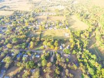 Scenic aerial view of green suburban area of Ozark, Arkansas, US. Aerial green suburban area near forest of Ozark, Arkansas, USA in autumn. Top overhead Royalty Free Stock Image