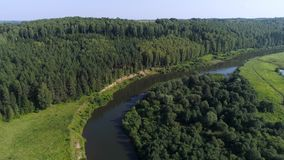 Aerial Green Summer Forest with Fields and River stock footage