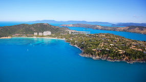 Aerial of Hamilton Island. In the Whitsundays, Queensland Australia. Reef and boats seen in the blue ocean with the resorts  along the shoreline. Other Stock Images