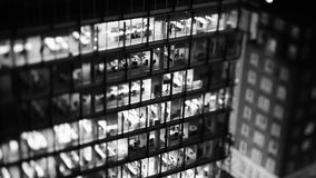 Tilt-shift lens over business skyscraper aerial black and white. Aerial helicopter view to skyscraper building in banking business district in worldwide hub with stock video
