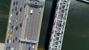 Aerial high angle of a boat moving under the bridge. Aerial high angle of a white boat moving under the bridge stock video footage