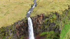 Aerial high angle view of a huge waterfall in Iceland, drone video stock video footage
