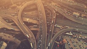 Aerial high drone flight over evening road traffic in Kiev. Ukraine. Highway and overpass with cars and trucks, interchange, two-level road junction in the big stock video