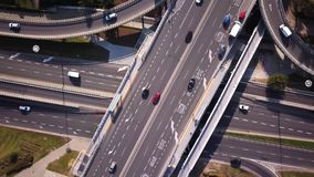 Aerial high drone flight over road traffic. Highway and overpass with cars and trucks, interchange, two-level road junction in the. Big city. Top view. Cars stock video footage