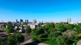 Aerial high view of Minsk, the capital of republic of Belarus. Summer cityscape with flying drone. Blue clear sky and green trees Stock Photos