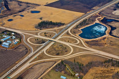 Aerial Highway Cloverleaf 1. An aerial view of a highway joining another highway in a cloverleaf pattern Royalty Free Stock Photo