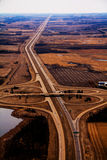 Aerial Highway Coverleaf west. An aerial view of 2 highways intersecting Royalty Free Stock Photo