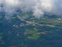 Aerial highway and green land under the clouds. Aerial highway and green land visible under the clouds interesting stock images