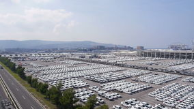 Aerial: highway next to the shipping port full of cars ready to transport stock video