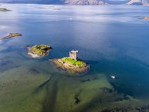 Aerial of the historic castle Stalker in Argyll in autumn, Scotland. United Kingdom stock images