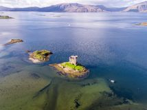 Aerial of the historic castle Stalker in Argyll in autumn, Scotland stock images