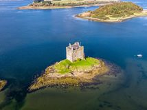 Aerial of the historic castle Stalker in Argyll in autumn, Scotland royalty free stock images