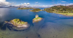 Aerial of the historic castle Stalker in Argyll in autumn, Scotland. United Kingdom stock photos