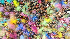 Aerial. Holi Colors Festival. People crowd and splash of paints. Top view. Aerial top view of a Holi Colors Festival. Splash of paint in a crowd of people view stock images