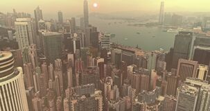 AERIAL. Hong Kong skyline. Hongkong hdr aerial cityscape with sunset sun. Amazing panorama of buildings and sky