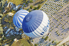Aerial hot air balloons patterns. Diagonal aerial shot of two hot air balloons on a low level flight path over the interesting limestone agricultural land of royalty free stock photos