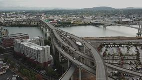 Aerial hyper lapse of Portland highway and bridge. This is an aerial hyper lapse of Portland highway and I-5 bridge over the river stock video footage