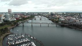 Aerial hyper time lapse of Portland river and bridges. This is an aerial hyper time lapse of Portland river and bridges stock video footage