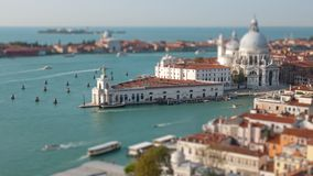 Aerial hyperlapse of Venice Grand Canal. Aerial tilt shift hyper lapse of Grand Canal traffic and Basilica di Santa Maria della Salute, view from Campanile stock footage