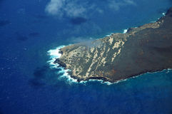 Aerial of Ilio Point on the Northwest coast of Molokai with wave. S crashing into shore and clouds in the air, largely undeveloped. April 2016 Stock Photography