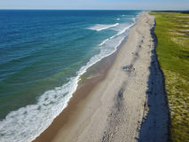 Aerial Image of Beautiful Beach on Cape Cod, MA. Waves from the Atlantic Ocean wash onto a scenic beach on Cape Cod, Massachusetts. This sandy peninsula is a Stock Images