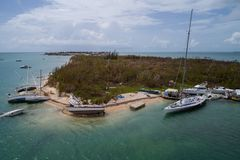 Sunken vessels after Hurricane Irma. Aerial image of boats under water in the Keys Florida after Hurricane Irma Royalty Free Stock Photo