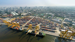 Aerial image of cargo ships at seaport with city view Royalty Free Stock Photography