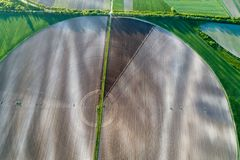 Round field with center irrigation system stock photo