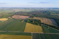 Aerial view of agricultural fields. Aerial image of cultivated land in spring time shoot from drone Royalty Free Stock Photography