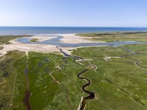 Aerial image of dutch national park with curving rivers in grass land towards the north sea on the island of Texel. Aerial image by drone of dutch national park stock image